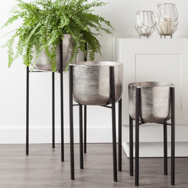 brushed aluminum metal planter in stand